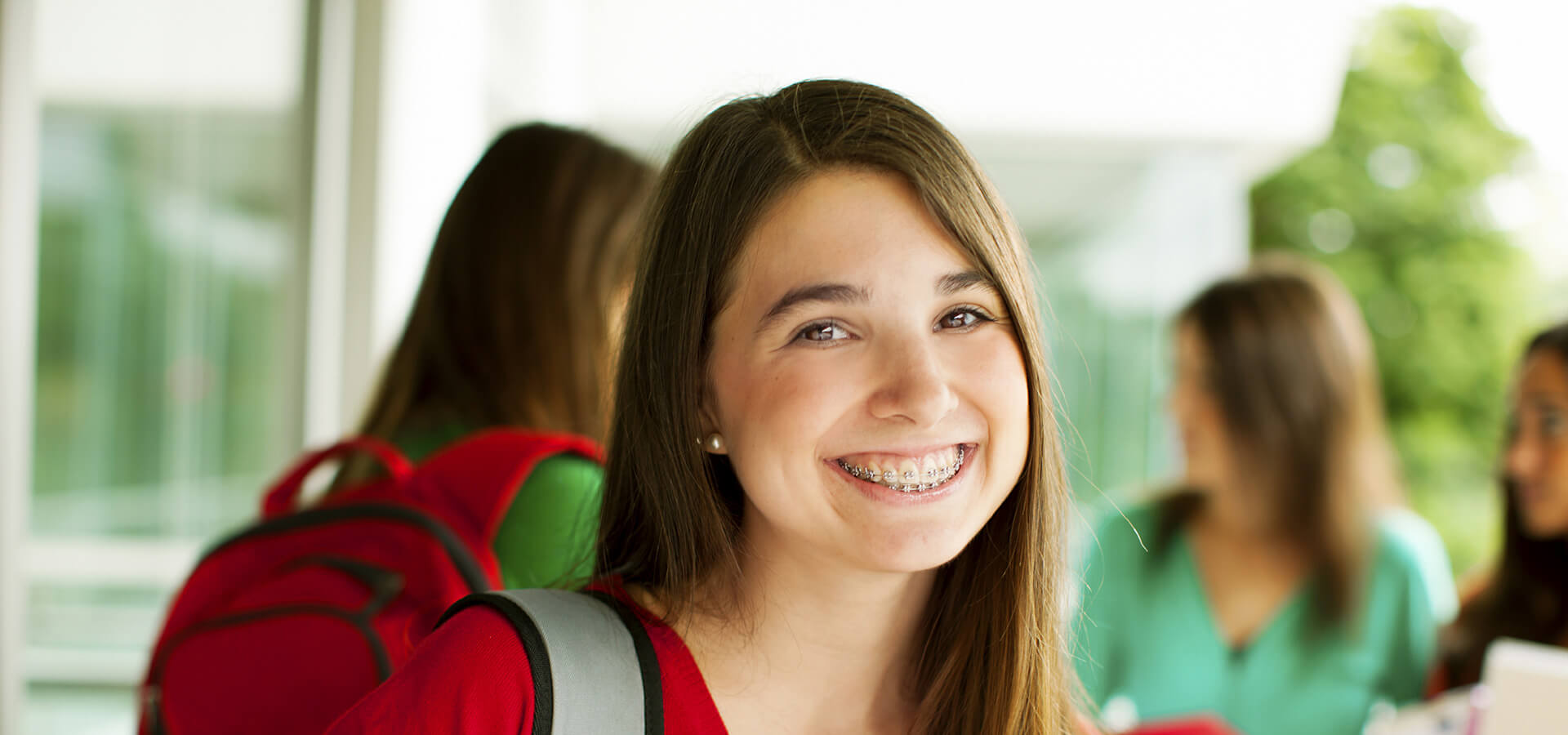 Smiling Brunette Teenage Girl in Braces
