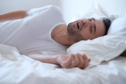 Man sleeping in bed and snoring
